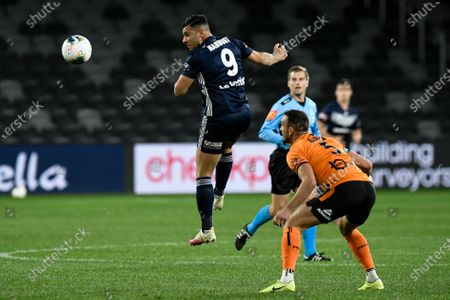 Andrew Nabbout of Melbourne Victory flicks on a header ahead of Tom Aldred of Brisbane Roar; Bankwest Stadium, Parramatta, New South Wales, Australia; A League Football, Melbourne Victory versus Brisbane Roar.