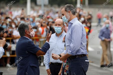 King Felipe VI (R) and Queen Letizia (unseen) of Spain are welcomed by Cantabria's regional President, Miguel Angel Revilla (L), during their visit to the National Cattle Market in Torrelavega, Cantabria, Spain, 29 July 2020. The Royal couple are visiting cities around the country to see the different social and economic situations after the coronavirus lockdown.