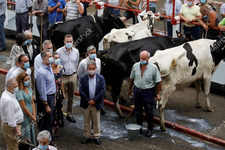 King Felipe VI (4L), Queen Letizia (5L) of Spain and Cantabria's regional President, Miguel Angel Revilla (2R), visit the National Cattle Market in Torrelavega, Cantabria, Spain, 29 July 2020. The Royal couple are visiting cities around the country to see the different social and economic situations after the coronavirus lockdown.