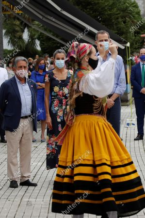 King Felipe VI (R) and Queen Letizia (2L) of Spain watch a traditional regional dance next to Cantabria's regional President, Miguel Angel Revilla (L), during their visit to the National Cattle Market in Torrelavega, Cantabria, Spain, 29 July 2020. The Royal couple are visiting cities around the country to see the different social and economic situations after the coronavirus lockdown. EFE/ Ballesteros