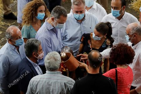 King Felipe VI (C-L), Queen Letizia (C-R) of Spain and Cantabria's regional President, Miguel Angel Revilla (2L, foreground), visit the National Cattle Market in Torrelavega, Cantabria, Spain, 29 July 2020. The Royal couple are visiting cities around the country to see the different social and economic situations after the coronavirus lockdown.
