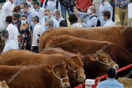 Queen Letizia (C-L) of Spain and Cantabria's regional President, Miguel Angel Revilla (2L), visit the National Cattle Market in Torrelavega, Cantabria, Spain, 29 July 2020. The Royal couple are visiting cities around the country to see the different social and economic situations after the coronavirus lockdown.