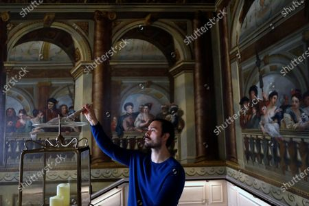 Historic Royal Palaces conservator dusts a candle holder above the King's Staircase, during a media opportunity at Kensington Palace in London, . Following over four months of closure during lockdown, Kensington Palace will be reopening its doors once more to welcome visitors from Thursday, July 30. To celebrate the re-opening, the famous 'Travolta dress', worn by the late Diana, Princess of Wales, will go on display at the palace for the first time since it was acquired by Historic Royal Palaces at auction in 2019