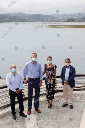 King Felipe VI (2-L) and Queen Letizia (2-R) of Spain pose next to Cantabria's regional Presidnet, Miguel Angel Revilla (R) and Spanish Minister of Justice, Juan Carlos Campo Moreno (L) visit Santona port in Cantabria, Spain, 29 July 2020. The Royal couple are visiting cities around the country to see the different social and economic situations after the Covid-19 coronavirus lockdown.