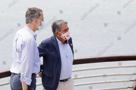 Stock Picture of King Felipe VI (L) and Cantabria's regional President, Miguel Angel Revilla (R), visit Santona port in Cantabria, Spain, 29 July 2020. The Royal couple are visiting cities around the country to see the different social and economic situations after the Covid-19 coronavirus lockdown.