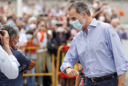 Stock Photo of King Felipe VI (R) greets Cantabria's regional President, Miguel Angel Revilla (L), during his visit to the National Cattle Market in Torrelavega, Cantabria, Spain, 29 July 2020. The Royal couple are visiting cities around the country to see the different social and economic situations after the Covid-19 coronavirus lockdown.
