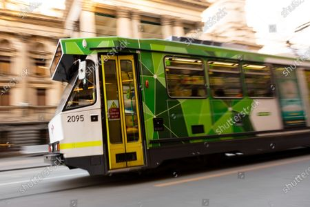 A view of a Melbourne Tram on Swanston Street with the Melbourne Town Hall seen in the background. As sustained high numbers of new Coronavirus cases are being discovered, Metropolitan Melbourne and the Mitchell Shire remain under Stage 3 restrictions with facemasks being made mandatory on 23 July. 295 new cases were found overnight bringing the states total active case numbers to 4,775.
