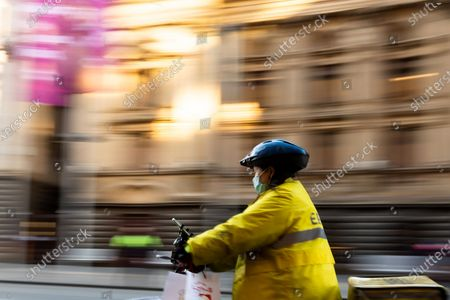 Food delivery riders are seen wearing facemasks. As sustained high numbers of new Coronavirus cases are being discovered, Metropolitan Melbourne and the Mitchell Shire remain under Stage 3 restrictions with facemasks being made mandatory on 23 July. 295 new cases were found overnight bringing the states total active case numbers to 4,775.