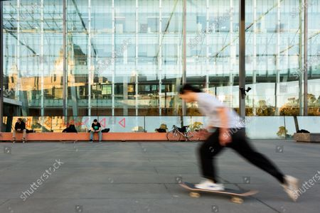 Skaters are seen enjoying the empty public spaces between the Melbourne Museum and the Royal Exhibition Building. Despite facemasks being mandatory, the vast majority did not choose to wear one. As sustained high numbers of new Coronavirus cases are being discovered, Metropolitan Melbourne and the Mitchell Shire remain under Stage 3 restrictions with facemasks being made mandatory on 23 July. 295 new cases were found overnight bringing the states total active case numbers to 4,775.