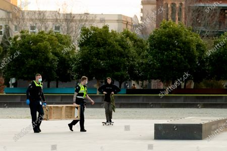 Police officers give a move on order to a skateboarder who refused to wear a facemask. They were met with a torrent of foul abuse and the man resisted arrest. The man was eventually arrested and later released. As sustained high numbers of new Coronavirus cases are being discovered, Metropolitan Melbourne and the Mitchell Shire remain under Stage 3 restrictions with facemasks being made mandatory on 23 July. 295 new cases were found overnight bringing the states total active case numbers to 4,775.