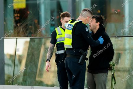 Police officers arrest an abusive skateboarder who tried to run from the officers as they gave him a move on order for not wearing a facemask and disturbing the peace. The man was later released. As sustained high numbers of new Coronavirus cases are being discovered, Metropolitan Melbourne and the Mitchell Shire remain under Stage 3 restrictions with facemasks being made mandatory on 23 July. 295 new cases were found overnight bringing the states total active case numbers to 4,775.
