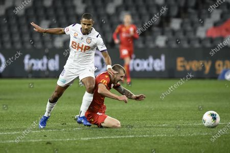 Stock Picture of James Meredith of Perth Glory brings down Riley McGree of Adelaide United just outside the penalty area; Bankwest Stadium, Parramatta, New South Wales, Australia; A League Football, Adelaide United versus Perth Glory.