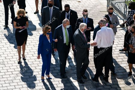 US House Speaker Nancy Pelosi (2-L) speaks with Senate Minority Leader Sen. Chuck Schumer (C) and House Majorit Steny Hoyer (9-R), after the casket of Rep. John Lewis was carried down the Capitol steps in Washington, DC, USA, 29 July 2020. John Lewis, who died 17 July 2020 from pancreatic cancer at age 80, lied in state atop the East Front steps of the US Capitol.