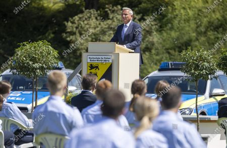 Stock Photo of Minister of the Interior, Digitisation and Migration for Baden-Wuerttemberg state Thomas Strobl speaks during the swearing-in ceremony for Police academy graduates in Biberach, Germany, 29  July 2020. According to the Ministry of the Interior, around 175 police officers are being sworn in today in Baden-Wuerttemberg state.