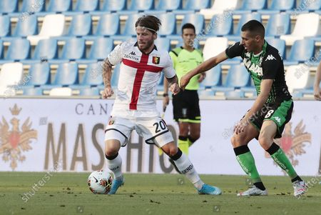 Sassuolo's Mehdi Bourabia (R) and Genoa's Lasse Schone (L) in action during the Italian Serie A soccer match US Sassuolo vs Genoa CFC at Mapei Stadium in Reggio Emilia, Italy, 29 July 2020.