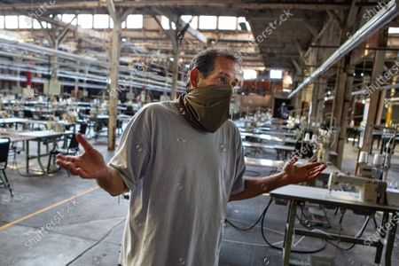LA Apparel, CEO, Dov Charney, 51, of Los Angeles stands in one of the many LA Apparel factory warehouses on Wednesday, July 15, 2020 in Los Angeles, CA. (Jason Armond / Los Angeles Times)