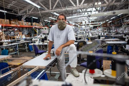LA Apparel, CEO, Dov Charney, 51, of Los Angeles poses for a portrait on the sewing floor at LA Apparel during an employee health and safety training session on Wednesday, July 15, 2020 in Los Angeles, CA. (Jason Armond / Los Angeles Times)