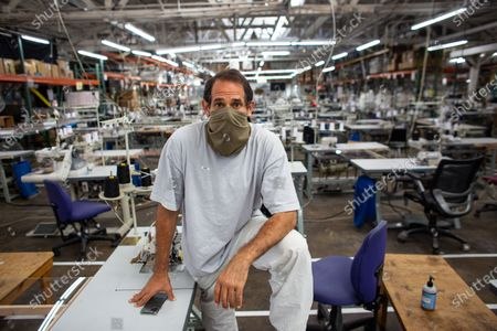 Stock Image of LA Apparel, CEO, Dov Charney, 51, of Los Angeles poses for a portrait on the sewing floor at LA Apparel during an employee health and safety training session on Wednesday, July 15, 2020 in Los Angeles, CA. (Jason Armond / Los Angeles Times)