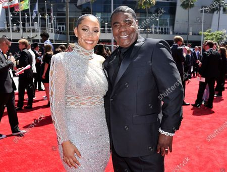"""Stock Image of Megan Wollover, left, and Tracy Morgan arrive at the ESPY Awards, in Los Angeles. Morgan and his wife of five years will part ways. The actor-comedian's representative said in an emailed statement Wednesday that Morgan and Wollover have filed for divorce. Morgan and Wollover married after the former """"Saturday Night Live"""" cast member recovered from a 2014 highway crash in which a Wal-Mart truck slammed into the back of a limo Morgan was riding in"""