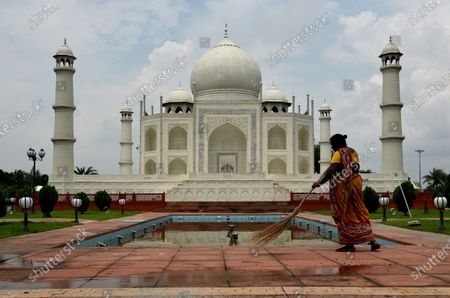 A worker cleans the premises of Taj Mahal replica at Seven Wonders of the World in Eco Park during the twice-a-week complete lockdown on July 29, 2020 in Kolkata, India. West Bengal chief minister Mamata Banerjee on Tuesday declared that state will continue with the lockdown protocol till August 31 with relaxations, but there will be two days in a week when there will be complete lockdown.