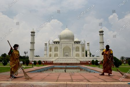 Workers clean the premises of Taj Mahal replica at Seven Wonders of the World in Eco Park during the twice-a-week complete lockdown on July 29, 2020 in Kolkata, India. West Bengal chief minister Mamata Banerjee on Tuesday declared that state will continue with the lockdown protocol till August 31 with relaxations, but there will be two days in a week when there will be complete lockdown.