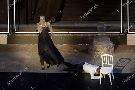 Stock Image of Peter Lohmeyer as Tod (Death) (L) and Austrian actor Tobias Moretti as Jedermann (Everyman) (R) perform on stage during a rehearsal of Hugo von Hofmannsthal's Jedermann (Everyman) at the Domplatz square in Salzburg, Austria, 29 July 2020. The play Jedermann is one of the highlights of the 110th Salzburg festival, which will run shortened form, due to the coronavirus COVID-19 pandemic, from 01 to 30 August 2020.
