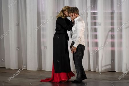 Stock Photo of Tobias Moretti as Jedermann (Everyman) (R) and German actress Caroline Peters as Buhlschaft (Paramour) (L) perform on stage during a rehearsal of Hugo von Hofmannsthal's Jedermann (Everyman) at the Domplatz square in Salzburg, Austria, 29 July 2020. The play Jedermann is one of the highlights of the 110th Salzburg festival, which will run shortened form, due to the coronavirus COVID-19 pandemic, from 01 to 30 August 2020.