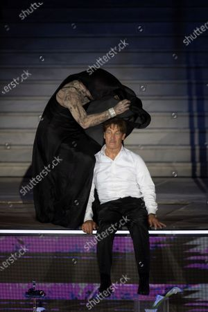 Stock Picture of Peter Lohmeyer as Tod (Death) (L) and Austrian actor Tobias Moretti as Jedermann (Everyman) (R) perform on stage during a rehearsal of Hugo von Hofmannsthal's Jedermann (Everyman) at the Domplatz square in Salzburg, Austria, 29 July 2020. The play Jedermann is one of the highlights of the 110th Salzburg festival, which will run shortened form, due to the coronavirus COVID-19 pandemic, from 01 to 30 August 2020.