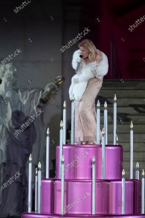 Caroline Peters as Buhlschaft (Paramour) performs on stage during a rehearsal of Hugo von Hofmannsthal's Jedermann (Everyman) at the Domplatz square in Salzburg, Austria, 29 July 2020. The play Jedermann is one of the highlights of the 110th Salzburg festival, which will run shortened form, due to the coronavirus COVID-19 pandemic, from 01 to 30 August 2020.