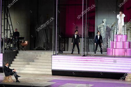Tobias Moretti as Jedermann (Everyman) (R) and German actress Caroline Peters as Buhlschaft (Paramour) (L) perform on stage during a rehearsal of Hugo von Hofmannsthal's Jedermann (Everyman) at the Domplatz square in Salzburg, Austria, 29 July 2020. The play Jedermann is one of the highlights of the 110th Salzburg festival, which will run shortened form, due to the coronavirus COVID-19 pandemic, from 01 to 30 August 2020.
