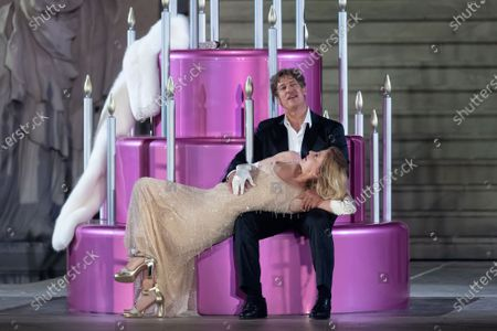 Tobias Moretti as Jedermann (Everyman) (L) and German actress Caroline Peters as Buhlschaft (Paramour) (R) perform on stage during a rehearsal of Hugo von Hofmannsthal's Jedermann (Everyman) at the Domplatz square in Salzburg, Austria, 29 July 2020. The play Jedermann is one of the highlights of the 110th Salzburg festival, which will run shortened form, due to the coronavirus COVID-19 pandemic, from 01 to 30 August 2020.