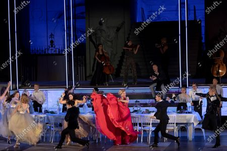 Stock Image of Caroline Peters as Buhlschaft (Paramour) performs on stage during a rehearsal of Hugo von Hofmannsthal's Jedermann (Everyman) at the Domplatz square in Salzburg, Austria, 29 July 2020. The play Jedermann is one of the highlights of the 110th Salzburg festival, which will run shortened form, due to the coronavirus COVID-19 pandemic, from 01 to 30 August 2020.