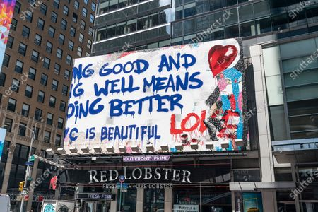 Stock Picture of Thierry Guetta aka Mr. Brainwash art seen on billboards on Ernst & Young headquarters on Times Square. These pieces of art depicts message of love to city of New York. The artist is a French-born and based in nowadays in Los Angeles.