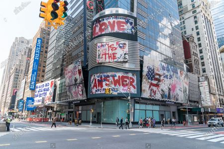 Stock Image of Thierry Guetta aka Mr. Brainwash art seen on billboards on Ernst & Young headquarters on Times Square. These pieces of art depicts message of love to city of New York. The artist is a French-born and based in nowadays in Los Angeles.