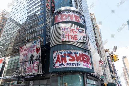 Thierry Guetta aka Mr. Brainwash art seen on billboards on Ernst & Young headquarters on Times Square. These pieces of art depicts message of love to city of New York. The artist is a French-born and based in nowadays in Los Angeles.