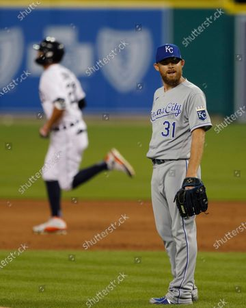 Kansas City Royals relief pitcher Ian Kennedy (31) stands near the mound as Detroit Tigers' JaCoby Jones rounds the bases on a solo home-run during the seventh inning of a baseball game, in Detroit