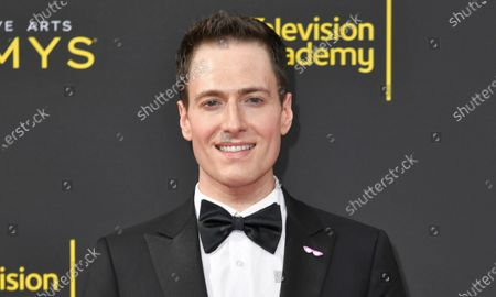 "Randy Rainbow arrives at the Creative Arts Emmy Awards, in Los Angeles. St. Martin's Press announced Wednesday that Rainbow's memoir ""Playing With Myself"" is scheduled for release late in 2021. The Emmy-nominated satirist, entertainer and host of the YouTube series ""The Randy Rainbow Show"" plans to ""set the record straight"" and let us see the world through his pink-rimmed glasses"
