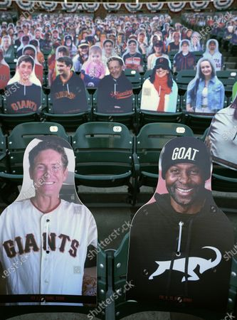 Cardboard cutouts of former football players Steve Young, from left, and Jerry Rice sit in seats at Oracle Park before a baseball game between the San Francisco Giants and the San Diego Padres in San Francisco