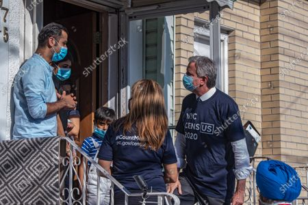 Mayor Bill de Blasio and NYC Census 2020 Director Julie Menin talk to Mr. Dodwani and family in Queens borough, New York City. Mayor Bill de Blasio and NYC Census 2020 Director Julie Menin go door-knocking to encourage New Yorkers to complete the census in South Richmond Hill, Queens.