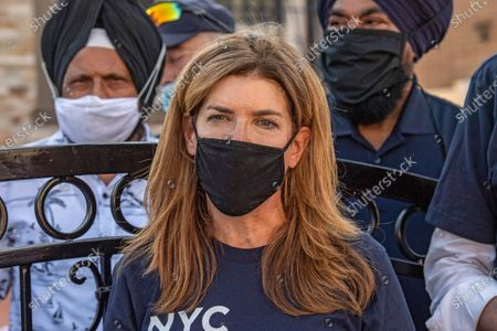 Director Julie Menin wearing a face mask while talking to the press about the importance of the US Census in Queens borough, New York City. Mayor Bill de Blasio and NYC Census 2020 Director Julie Menin go door-knocking to encourage New Yorkers to complete the census in South Richmond Hill, Queens.
