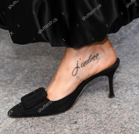 Stock Image of Stacey Dooley 'j'adore' foot tattoo