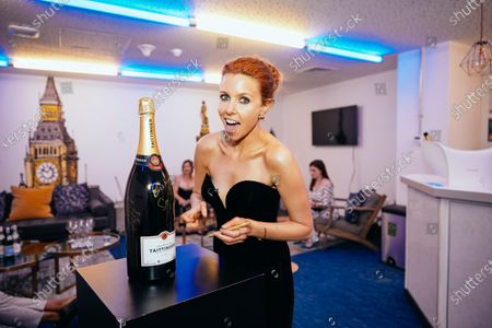 Stacey Dooley signs the Taittinger Methuzelah backstage at the 2020 Virgin Media British Academy Television Awards