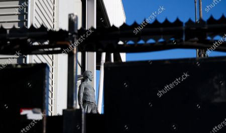 Stock Image of The Statue of George Cohen from outside the ground by the new stand construction