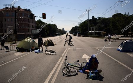 A protester reads a book during a blockade of a large boulevard on Eagle Bridge in Sofia, Bulgaria, 30 July 2020. Thousands have gathered at the anti-government protest demanding the resignation of the populist Prime Minister Boyko Borissov and Chief Prosecutor Ivan Geshev, who are accused of having ties to oligarchs and serving the interest of the mafia, not the citizens, according to media reports. The protesters are demanding the withdrawal of the entire government, which they consider corrupt and demand new early elections.