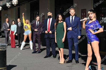 (L-R) Dwayne Johnson, Victoria and David Beckham, Beyoncé,  Eddie Redmayne, Donald Trump, Meghan Duchess of Sussex and Prince Harry, Taylor Swift at Madame Tussauds re-opening in Londonn