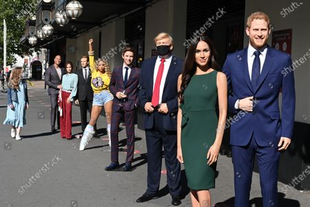 (L-R) Dwayne Johnson, Victoria and David Beckham, Beyoncé,  Eddie Redmayne, Donald Trump, Meghan Duchess of Sussex and Prince Harry at Madame Tussauds re-opening in Londonn