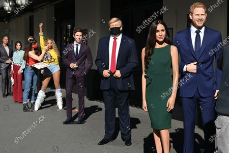 (L-R) Dwayne Johnson, Victoria and David Beckham, Beyoncé,  Eddie Redmayne, Donald Trump, Meghan Duchess of Sussex and Prince Harry at Madame Tussauds re-opening in London