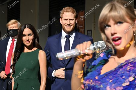 (L-R) Donald Trump, Meghan Duchess of Sussex and Prince Harry,Taylor Swift at Madame Tussauds re-opening in London