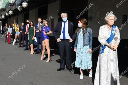 (L-R) Dwayne Johnson, Victoria and David Beckham, Beyoncé,  Eddie Redmayne, Donald Trump, Meghan Duchess of Sussex and Prince Harry,Taylor Swift, Boris Johnson, The Queen at Madame Tussauds re-opening in London