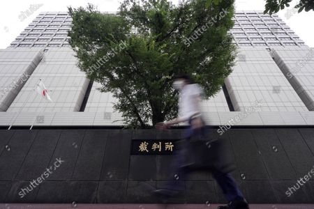 Tokyo District Court is seen where former Nissan Motor Co.'s executive Greg Kelly arrives for a pre-trial meeting in Tokyo . Former Nissan executive Kelly, who was arrested in connection with the financial scandal of his ex-boss Carlos Ghosn, will soon face trial in a Tokyo court. Both cases had been in limbo after Ghosn fled to Lebanon